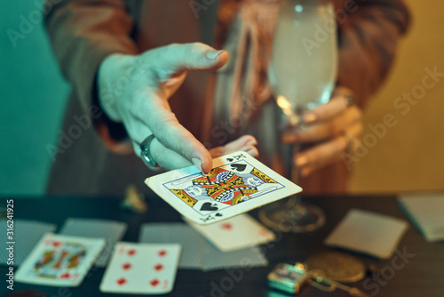 Fotografie, Tablou  Fortune teller hands with jewelry showing playing cards