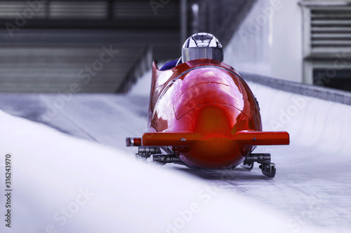 bob sled speeding in an ice channel Fotobehang