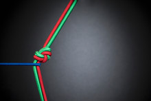 Blue Rope Tugging At Red And Green Rope Knotted In Teamwork, Unity