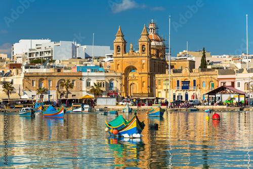 Traditional fishing boats in the Mediterranean Village of Marsaxlokk, Malta Wallpaper Mural