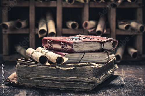 Magic scrolls and books in medieval library Canvas Print