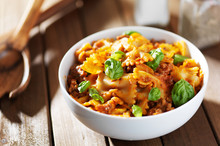 Farfalle Pasta With Hamburger Meat And Basil Leaves In Spaghetti Sauce