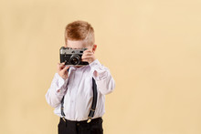 Child With Vintage Camera. Fas...