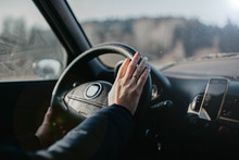 Female Hands On The Steering W...