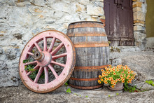 An Old Wagon Wheel, A Wooden B...