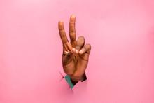 Black Person Hand Through A Ho...
