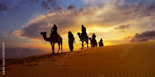 Caravan of camel in the sahara desert of Morocco at sunset time Wallpaper Mural