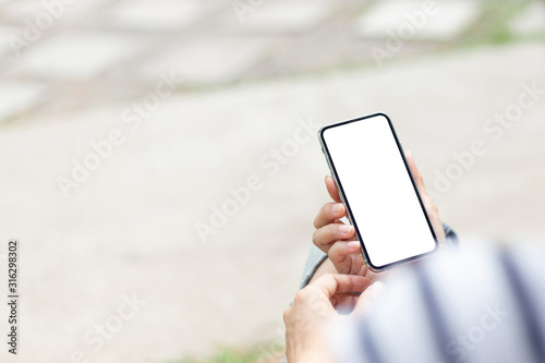 Fototapety, obrazy: Mockup image blank white screen cell phone.man hand holding texting using mobile on desk at coffee shop.background empty space for advertise text.people contact marketing business,technology