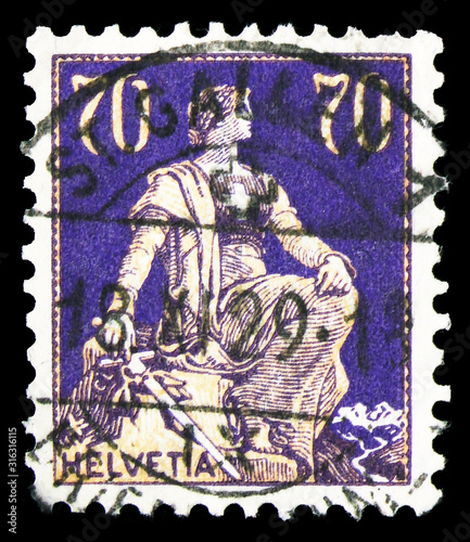 Obraz na plátně Postage stamp printed in Switzerland shows Helvetia with sword, serie, 70 Ct