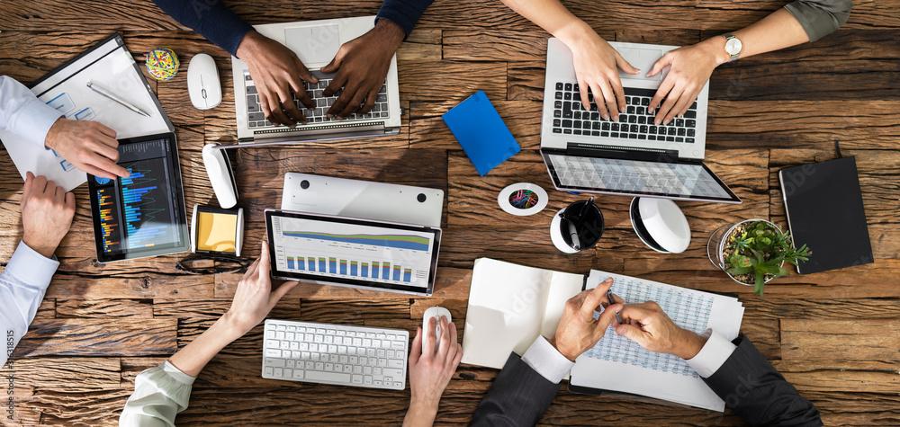 Fototapeta Businesspeople Working At Office