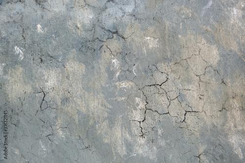 Fototapeta Weathered old grey cracked background with rough surface. obraz