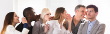 Secretive Business Colleagues Whispering In The Office