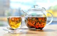 A  Glass Teapot With Tea And A...