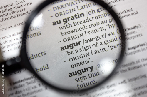 Photo The word of phrase - augur - in a dictionary.