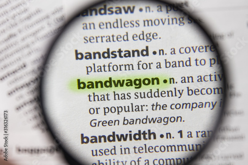 The word or phrase bandwagon in a dictionary. Canvas Print