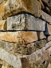 Old Stone Wall Of Stones Corner