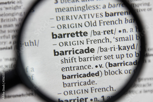 Photo The word or phrase barricade in a dictionary.