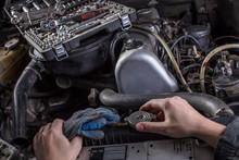 Car Engine Repair. Engine Cooling System Services. Hands With A Mechanic With A Wrench Repair Mercedes Parts.