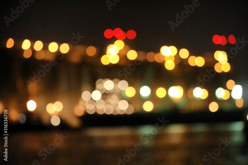 Obraz Blurred view of docks at night. Bokeh effect - fototapety do salonu