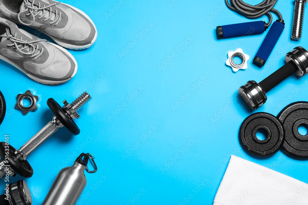 Fototapeta Gym equipment on light blue background, flat lay. Space for text - obraz na płótnie