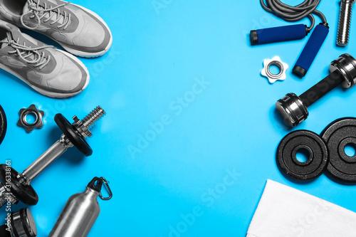 Fototapeta Gym equipment on light blue background, flat lay. Space for text obraz na płótnie