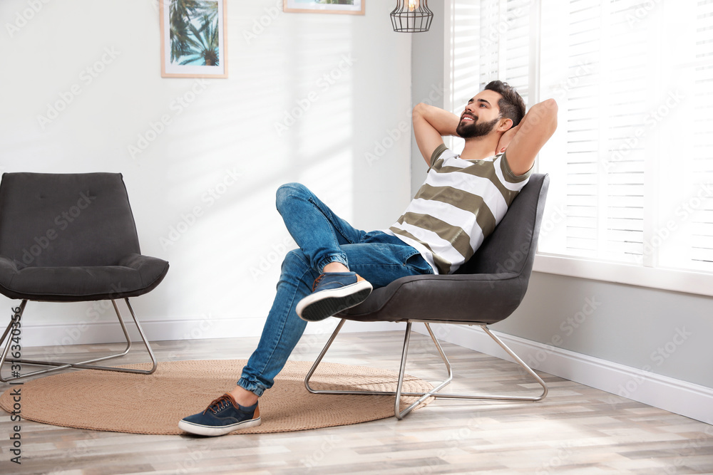 Fototapeta Young man relaxing at home. Peaceful rest