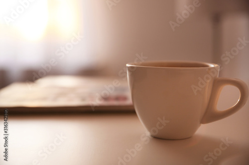 Obraz Cup of tasty drink on table, space for text. Lazy morning - fototapety do salonu