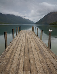 Fototapeta Rzeki i Jeziora Landscape photo of a jetty on Lake Rotoiti, New Zealand. This jetty is within the Nelson Lakes National Park and is one of the most Instagrammed locations in New Zealand