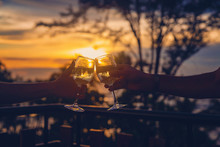 With Glasses Of Wine At Sunset...