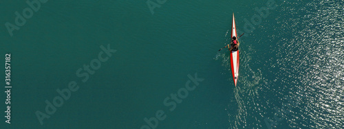 Valokuva Aerial drone ultra wide photo of fit athletes practising sport kayak in tropical