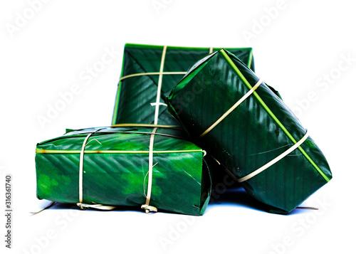 Photo Studio shot three Chung Cakes (square sticky rice cake) Vietnamese New Year food