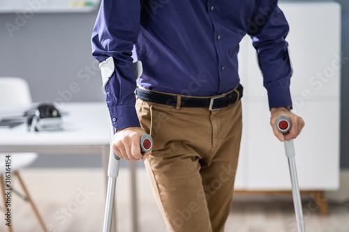 Fotografia Handicapped Man Walking With Crutches