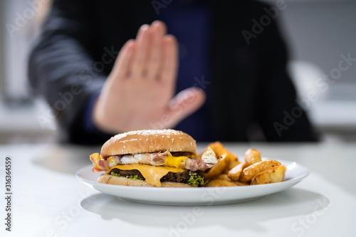 Man Refusing To Eat Burger Fototapet