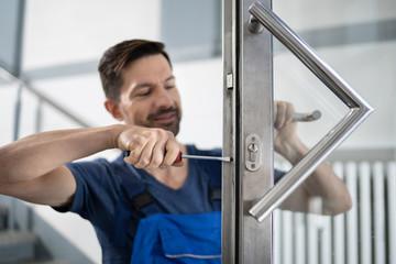 Fototapeta na wymiar Handyman Fitting A New Door