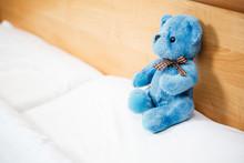 Teddy Bear On An Empty Clean Bed