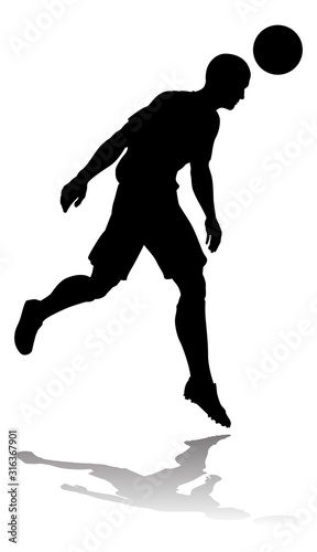 A soccer or football player in silhouette Canvas Print