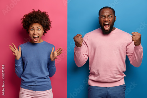 Photo of annoyed rude woman and man scream with agression, grimace and gesture a Fototapet