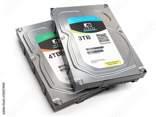 Photo Hard disk drive HDD of different size isolated on white.