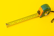 Leinwanddruck Bild - Repair, construction and tools background. Measuring tape on a yellow background. Copy space