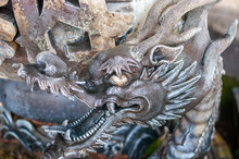 A Closeup Of A Bronze Dragon S...