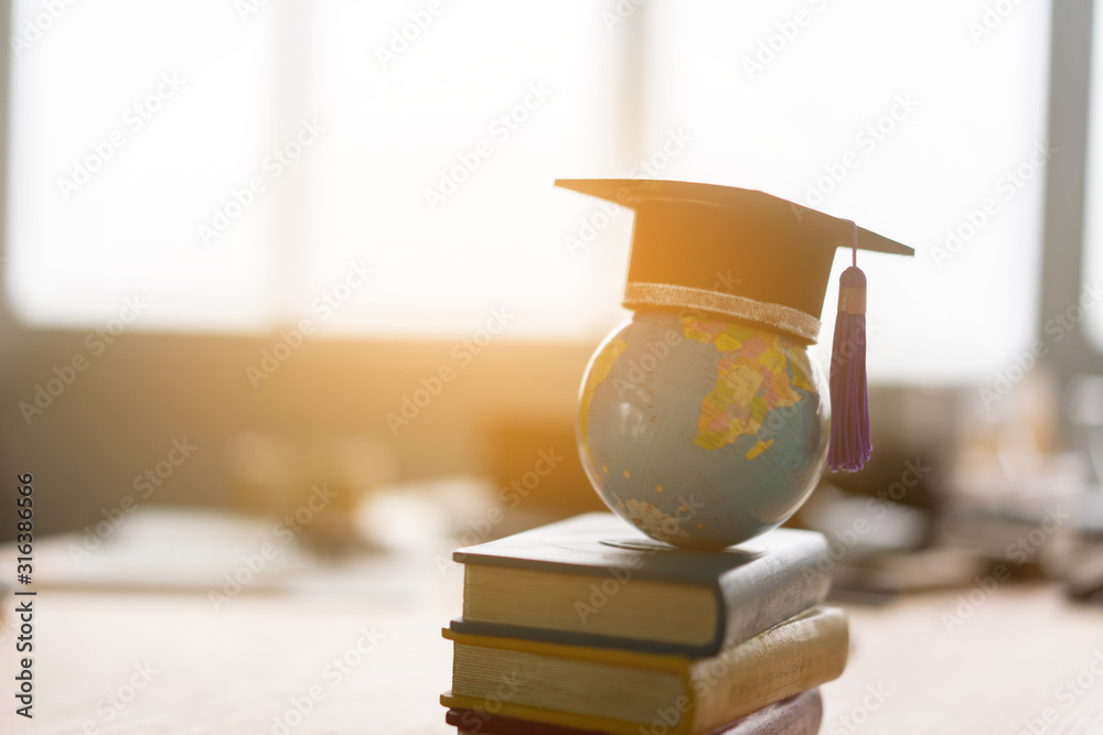 Fototapeta Education study abroad in Global world,Back to School and Graduation cap on student hand holding Earth globe map,Success of Global business study abroad educational,congratulation Graduation Ceremony
