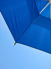 Umbrella Against Blue Clear Sky, Summer At The Beach