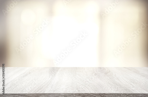 Obraz image of wooden table in front of abstract blurred window light background - fototapety do salonu