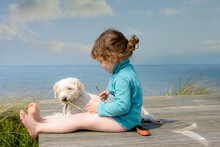 Cute Little Girl And Her Dog In Summer On A Terrace
