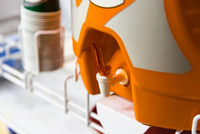 Orange Water Cooler Used To Hy...