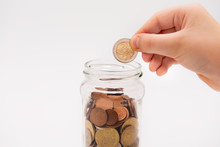 Saving Money, Hand Puts A Coin...