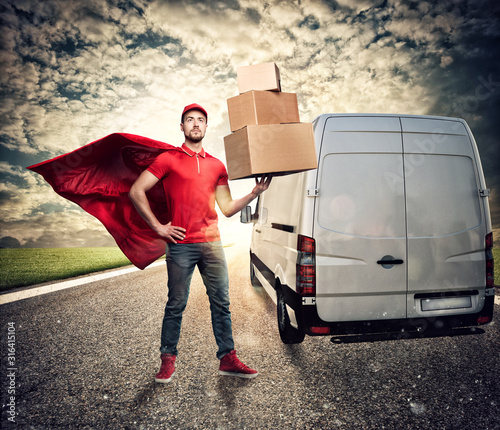 Courier acts like a powerful superhero in a city with skyscrapers Canvas Print