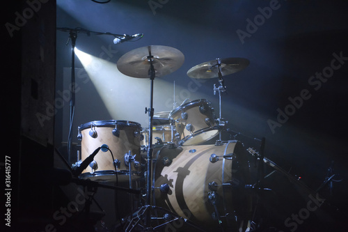 Drumset on a stage with one lightsource Canvas Print