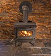 Burning Wood Stove With Stone ...