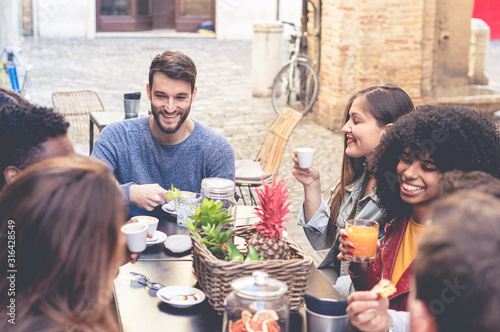 Group of young multiracial people having breakfast in an outdoor coffee shop Wallpaper Mural